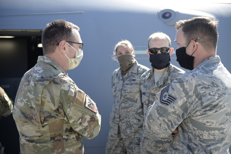 Gen. Joseph L. Lengyel, the Chief of the National Guard Bureau, talks with (from left to right) Senior Airman Kayla Orner, Tech. Sgt. Ariel Feindel and Tech. Sgt. Nicholas Johnston at Pease Air National Guard Base, Newington, N.H., May 27, 2020. The general presented coins to the trio for outstanding performance. (U.S. Air National Guard photo by Senior Master Sgt. Timm Huffman)