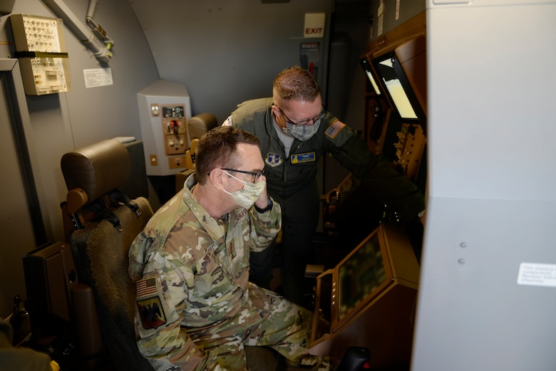 Tech. Sgt. Wayne Reid, a 157th Air Refueling Wing boom operator, demonstrates various aspects of the KC-46A boom controls to Gen. Joseph L. Lengyel, the Chief of the National Guard Bureau, during the general's visit to Pease Air National Guard Base, Newington, N.H., May 27, 2020. (U.S. Air National Guard photo illustration by Senior Master Sgt. Timm Huffman)