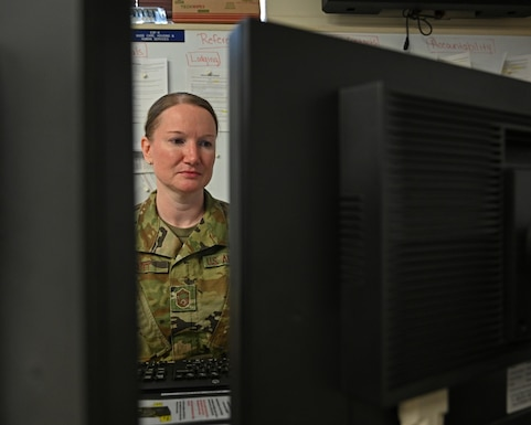 U.S. Air Force Senior Master Sgt. Stephanie Scott, 175th Wing Emergency Operations Center manager, sits at her computer in the Emergency Operations Center at Warfield Air National Guard Base, Middle River, Md., May 21, 2020. The 175th Wing established the EOC during the states response to the COVID-19 pandemic. (U.S. Air National Guard photo by Master Sgt. Christopher Schepers)