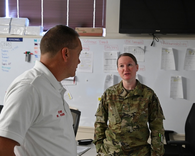 U.S. Air Force Senior Master Sgt. Stephanie Scott, 175th Wing Emergency Operations Center manager, speaks with Fire Chief Wayne Viands, 175th Emergency Operations Center manager, in the Emergency Operations Center at Warfield Air National Guard Base, Middle River, Md., May 21, 2020. The 175th Wing established the EOC during the states response to the COVID-19 pandemic. (U.S. Air National Guard photo by Master Sgt. Christopher Schepers)