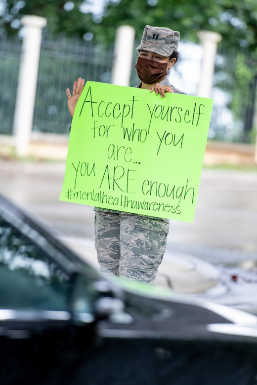 Airman hold signs up outside the Day Street gate.