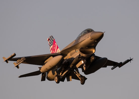 F-16 Fighting Falcons at dusk