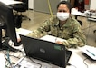 Lt. Col. Maria Espiritu, a clinical laboratory officer, working at Joint Base San Antonio Apr. 20 in support of the Department of Defense COVID-19 Response mission. Espiritu provides guidance to multiple clinical laboratories in the U.S. that provide testing for military medical professionals mobilized to support areas heavily impacted by COVID-19.