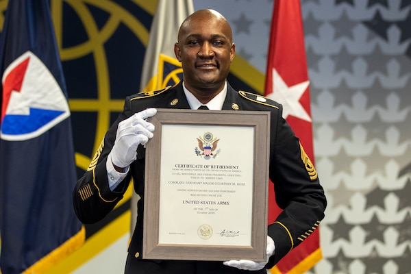 Command Sgt. Maj. Courtney M. Ross, U.S. Army Financial Management Command senior enlisted advisor, grins as he shows off his certificate of retirement during a ceremony at the Maj. Gen. Emmett J. Bean Federal Center in Indianapolis May 15, 2020. Ross, a native of North Augusta, South Carolina, joined the Army as an accounting specialist in 1996. (U.S. Army photo by Mark R. W. Orders-Woempner)