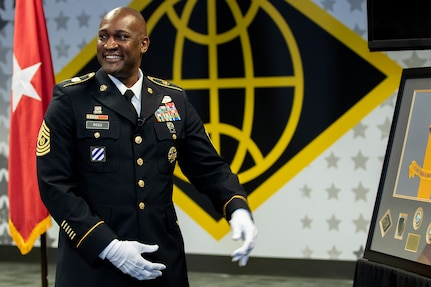 Command Sgt. Maj. Courtney M. Ross, U.S. Army Financial Management Command senior enlisted advisor, reacts after being presented with a military shadow box from USAFMCOM Soldiers and civilian employees during his retirement ceremony at the Maj. Gen. Emmett J. Bean Federal Center in Indianapolis May 15, 2020. Ross served as USAFMCOM's second command sergeant major after its designation as a two-star command and helped oversee the command's transition from a direct reporting unit to a major subordinate command under the Army Materiel Command. (U.S. Army photo by Mark R. W. Orders-Woempner)