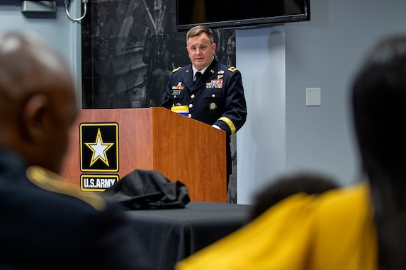 Brig. Gen. Mark S. Bennett, U.S. Army Financial Management Command commanding general, delivers his parting words to Command Sgt. Maj. Courtney M. Ross, USAFMCOM senior enlisted advisor, and his wife, Jessica, during Ross' retirement ceremony at the Maj. Gen. Emmett J. Bean Federal Center in Indianapolis May 15, 2020. Ross retired after more than 24 years of military service. (U.S. Army photo by Mark R. W. Orders-Woempner)