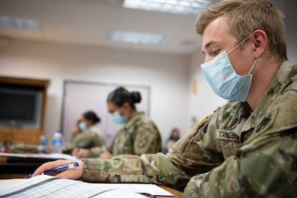 A member of the Oklahoma Army National Guard checks his list of contacts before making a phone call as part of contact tracing operations at the Texas County Health Department in Guymon, Oklahoma, May 15, 2020, in a multi-agency effort to slow the spread of COVID-19 in the state.
