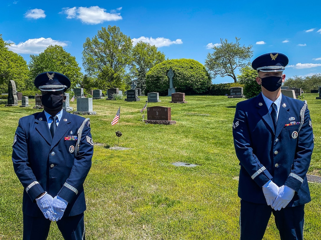 Wright-Patterson Air Force Base Honor Guard members Staff Sgt. Sean Chapman, left, and Senior Airman Rodney Petrie honor the life of Hilton Carter, a Tuskegee Airman, May 13 at St. Joseph Cemetery just south of Columbus along Route 23, not far from Rickenbacker Airport, Columbus. (Contributed photo)