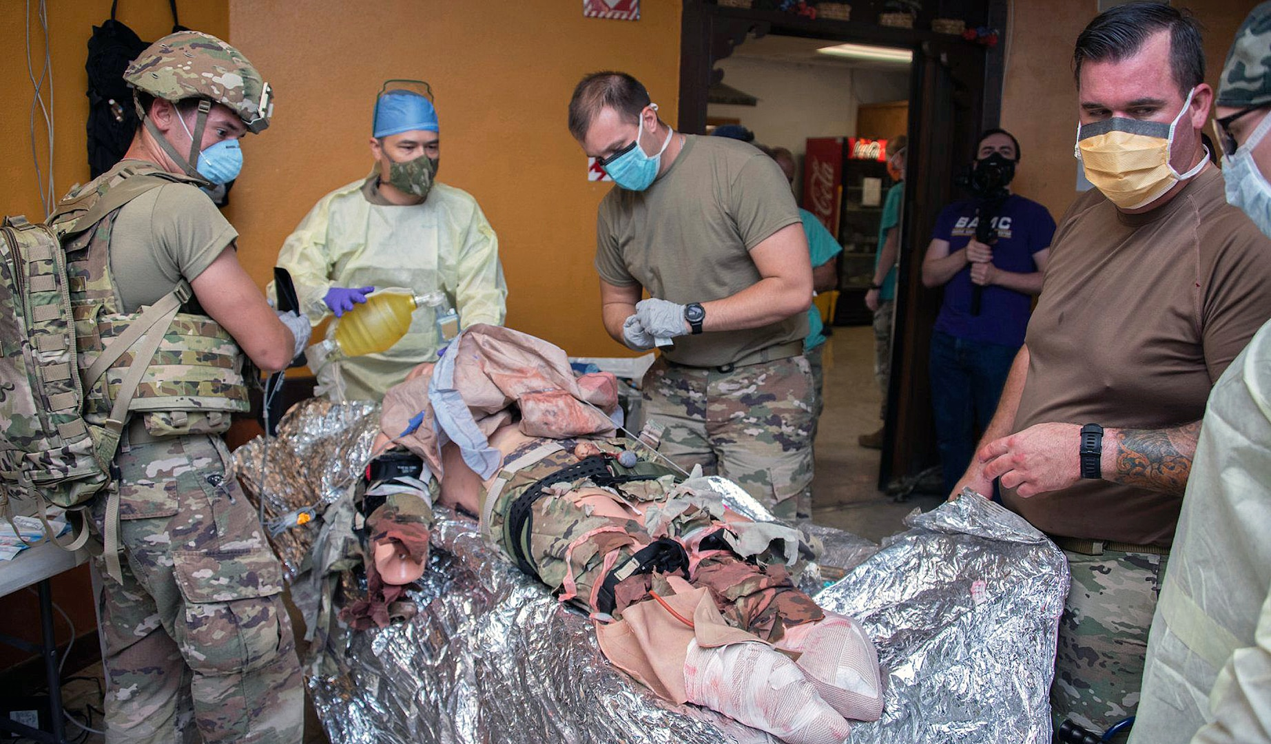 Members of the 555th Forward Surgical Team assess a simulated patient