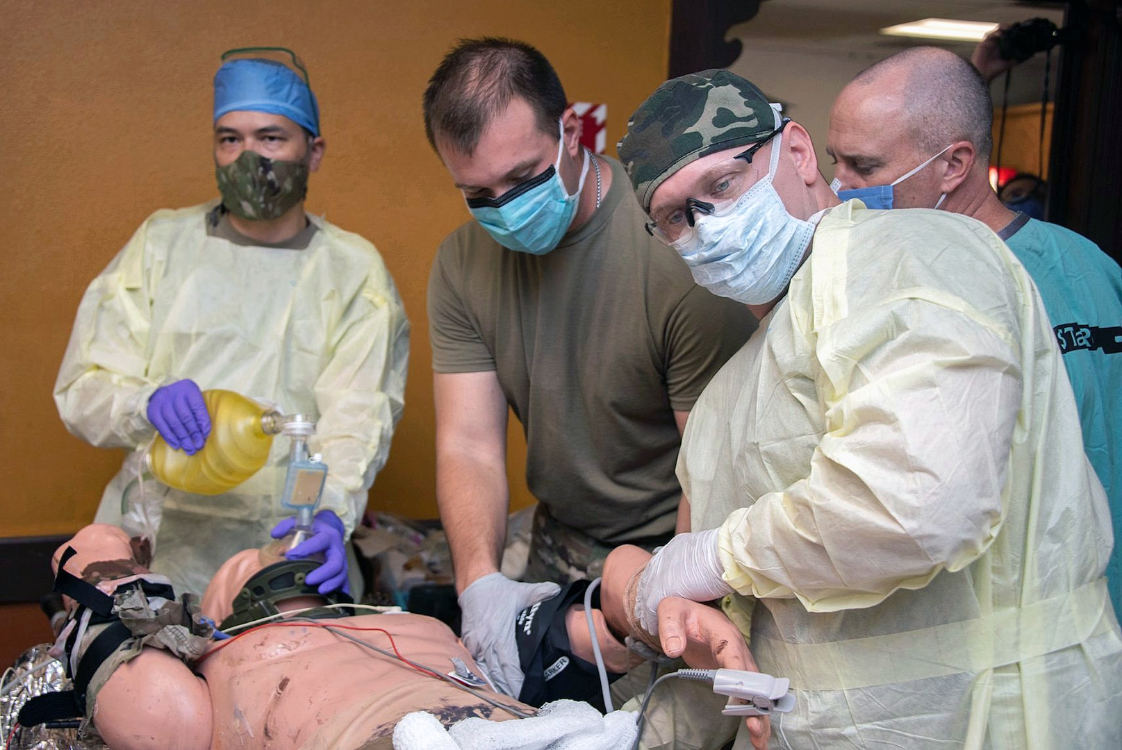 Members of the 555th Forward Surgical Team assess a simulated patient during training with Brooke Army Medical Center's Strategic Trauma Readiness Center of San or STaRC, at Joint Base San Antonio-Camp Bullis May 26. The STaRC training program uses a combination of didactic and hands-on learning to prepare the 555th for deployment.