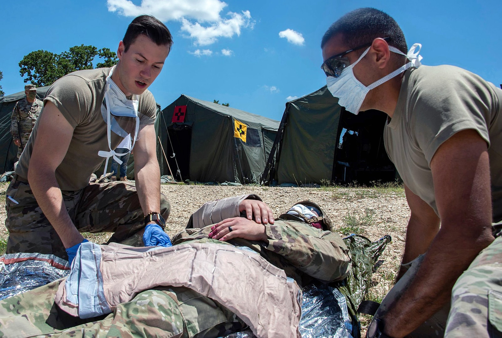 Members of the 555th Forward Surgical Team assess a simulated combat casualty