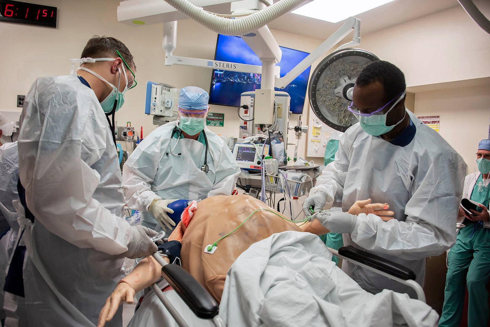Members of the 555th Forward Surgical Team assess a simulated trauma patient