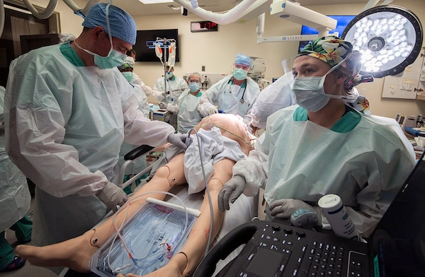 Members of the 555th Forward Surgical Team assess a simulated trauma patient during training with the Strategic Trauma Readiness Center of San Antonio, or STaRC, at Brooke Army Medical Center, Joint Base San Antonio-Fort Sam Houston May 28. T
