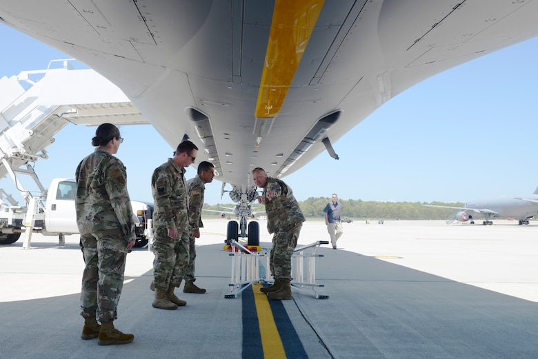 Col. John Pogorek, 157th Air Refueling Wing Commander, answers questions from Gen. Joseph L. Lengyel, the Chief of the National Guard Bureau, about the KC-46A Pegasus during the general's visit to Pease Air National Guard Base, Newington, N.H., May 27, 2020. Pictured from left to right are Chief Master Sgt. Erica Rhea, 157th ARW Command Chief, Gen. Lengyel, Maj. Gen. David Mikolaities, New Hampshire National Guard Adjutant General, and Col. Pogorek. (U.S. Air National Guard photo by Senior Master Sgt. Timm Huffman)