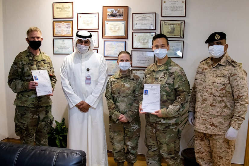 From left: U.S. Army Col Ian Black, command surgeon for 1st Theater Sustainment Command, Sheik Abdullah M. Al-Sabah, chief of medical services for the Kuwait Ministry of Defense, U.S. Army Maj. Adrienne Kramer, deputy command surgeon for Area Support Group – Kuwait, U.S. Army Capt. Yusheng Chen, ASG-KU command dentist, and Dr. Raed R. Altajalli, a Kuwaiti medical officer. Black and Chen are the first U.S. military personnel to be medically licensed for practice at Kuwait Ministry of Defense hospitals, an initial step towards medical interoperability between the two nations. (U.S. Army photo by Sgt. Sean Harding)