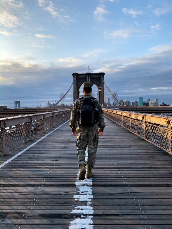 U.S. Army Engineer Research and Development Center's Cold Regions Research and Engineering Laboratory Research Associate Army 1st Lt. Eoghan Matthews walks across the Brooklyn Bridge on his way to work at the U.S. Army Corps of Engineers (USACE) New York District, March 26, 2020. 