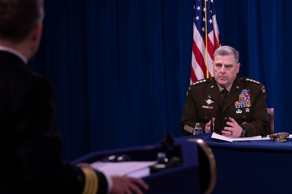 A military officer speaks at a briefing.