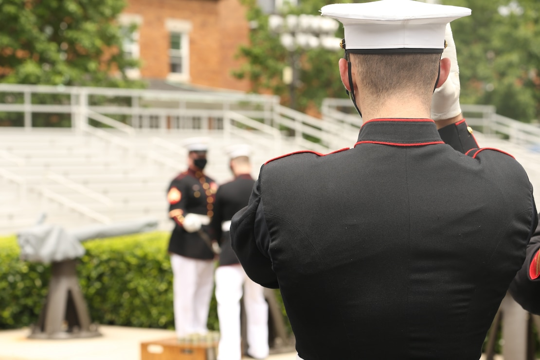 Body Bearers fire a cannon on the parade deck at Marine Barracks Washington, D.C., May 26.