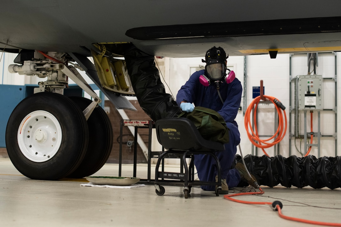 Airman 1st Class Dezmond Ross, 100th Maintenance Squadron fuel systems repair apprentice, retrieves a tool while inspecting the condition of a KC-135 Stratotanker fuel bladder at RAF Mildenhall, England, May 27, 2020. By bringing tools even if they aren't expected to be needed, fuel systems Airmen eliminate the need for tool retrieval in the middle of a job, decreasing the time it takes to perform maintenance on aircraft. (U.S. Air Force photo by Airman 1st Class Joseph Barron)