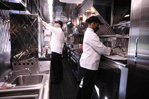Cooks prepare to work in an Army food truck in Germany.