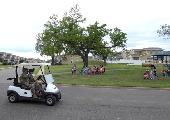 Col. Paul Filcek, 72nd Air Base Wing and Tinker installation commander, waves at base housing residents during the Chalk It Up Parade on May 27. Filcek was joined by several other Tinker leaders, members of base helping agencies, security forces and fire personnel along the parade route.