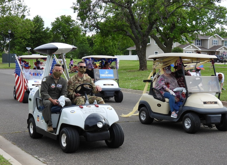 The signature 552nd Air Control Wing AWACS golf cart, driven by 552nd ACW Command Chief Master Sgt. Raymond Mott and Wing Commander Col. Alain Poisson, was one of many that hit the streets of base housing residents May 27 for the Chalk It Up Parade.