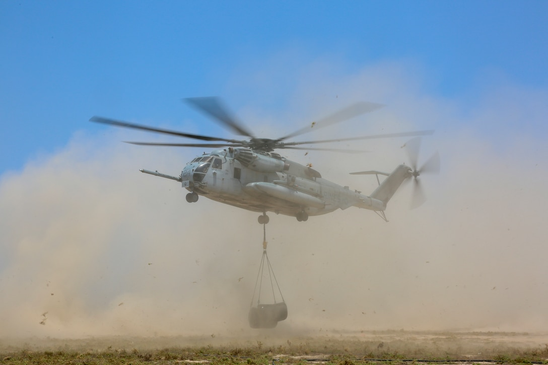 A CH-53E Super Stallion delivers fuel bladders to a forward arming and refueling point during routine sustainment on Karan Island, Saudi Arabia, May 27.