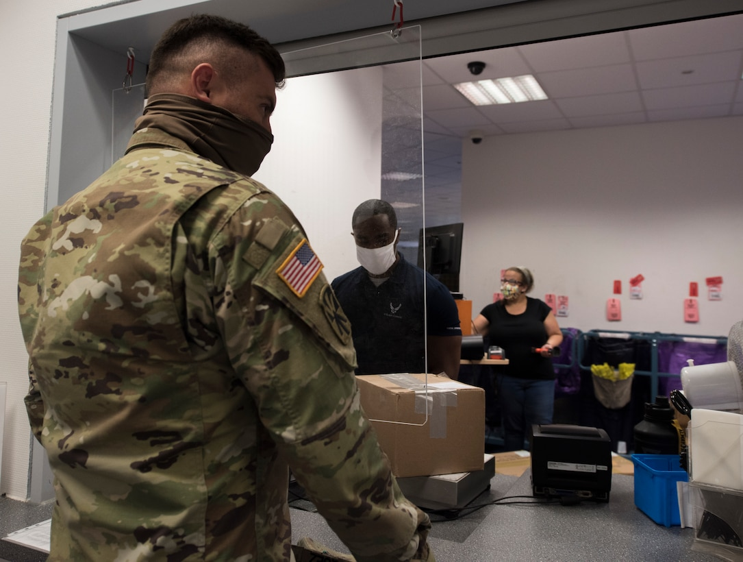 A photo of an Airman's package being weighed.