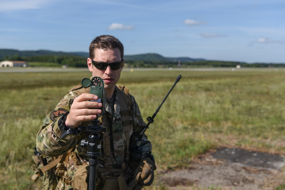 Photo of Airman using an anemometer