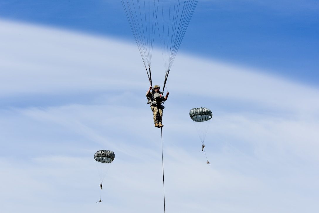 Photo of paratroopers descending to the ground