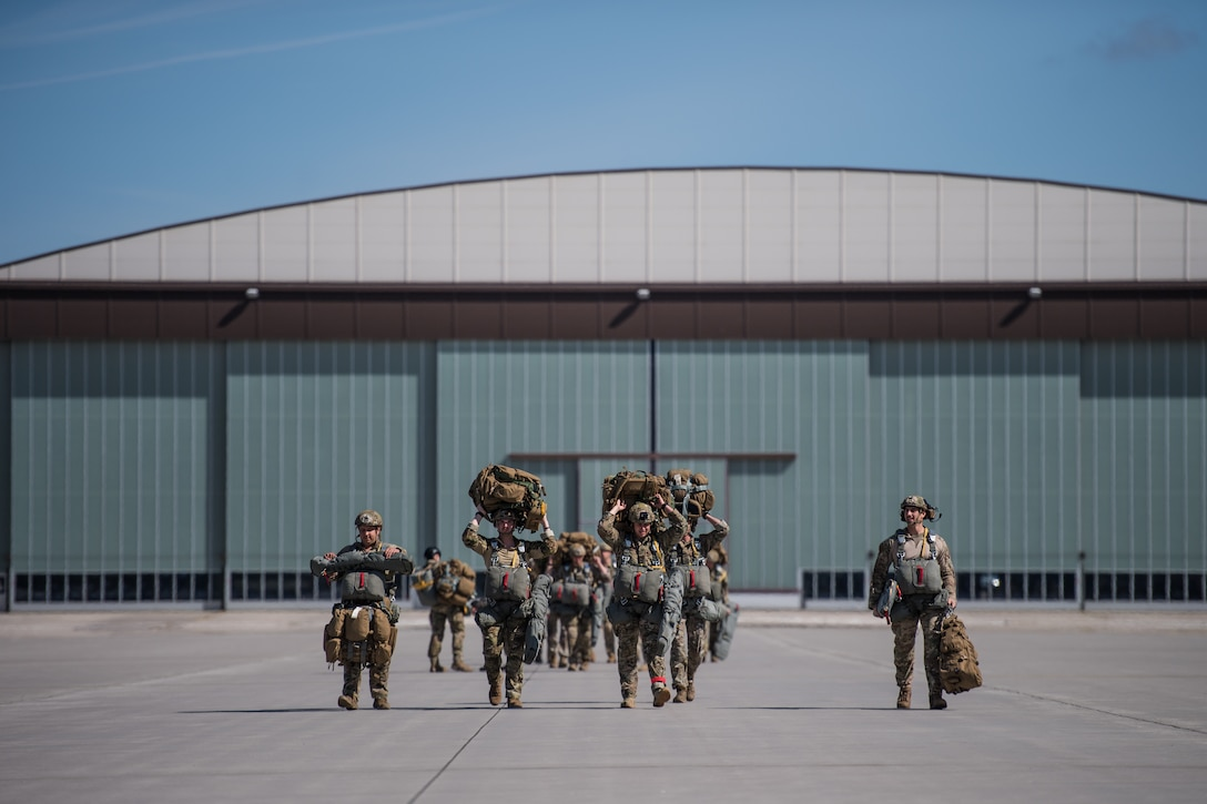 Photo of Airmen walking down a flightline