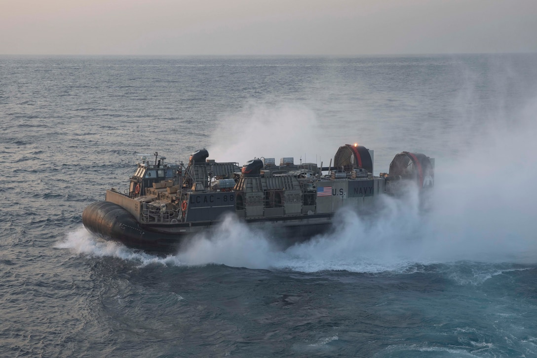 Landing Craft, Air Cushion 88 exits the well deck of the amphibious assault ship USS Bataan (LHD 5), May 27.