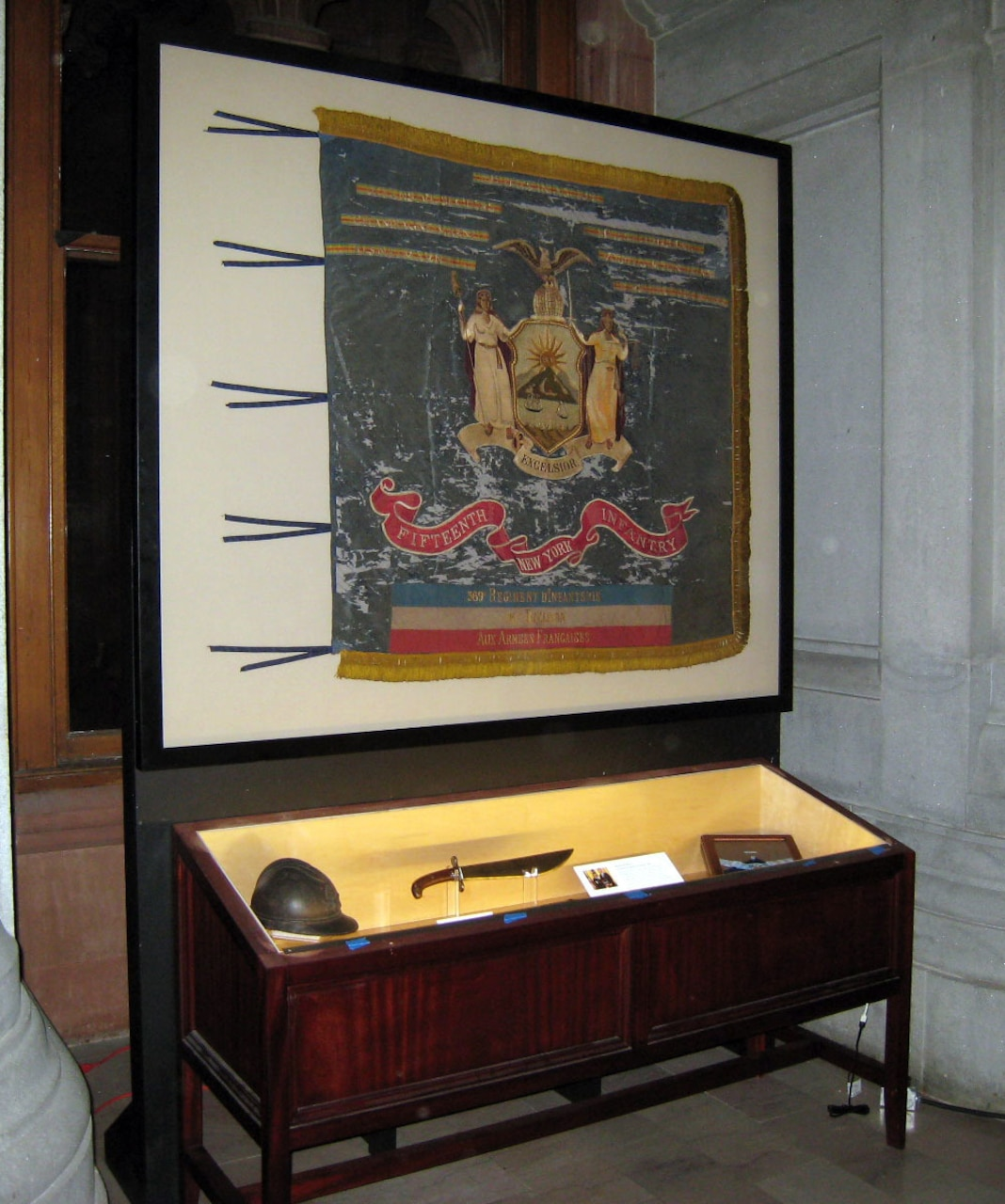 A museum display case holds artifacts.