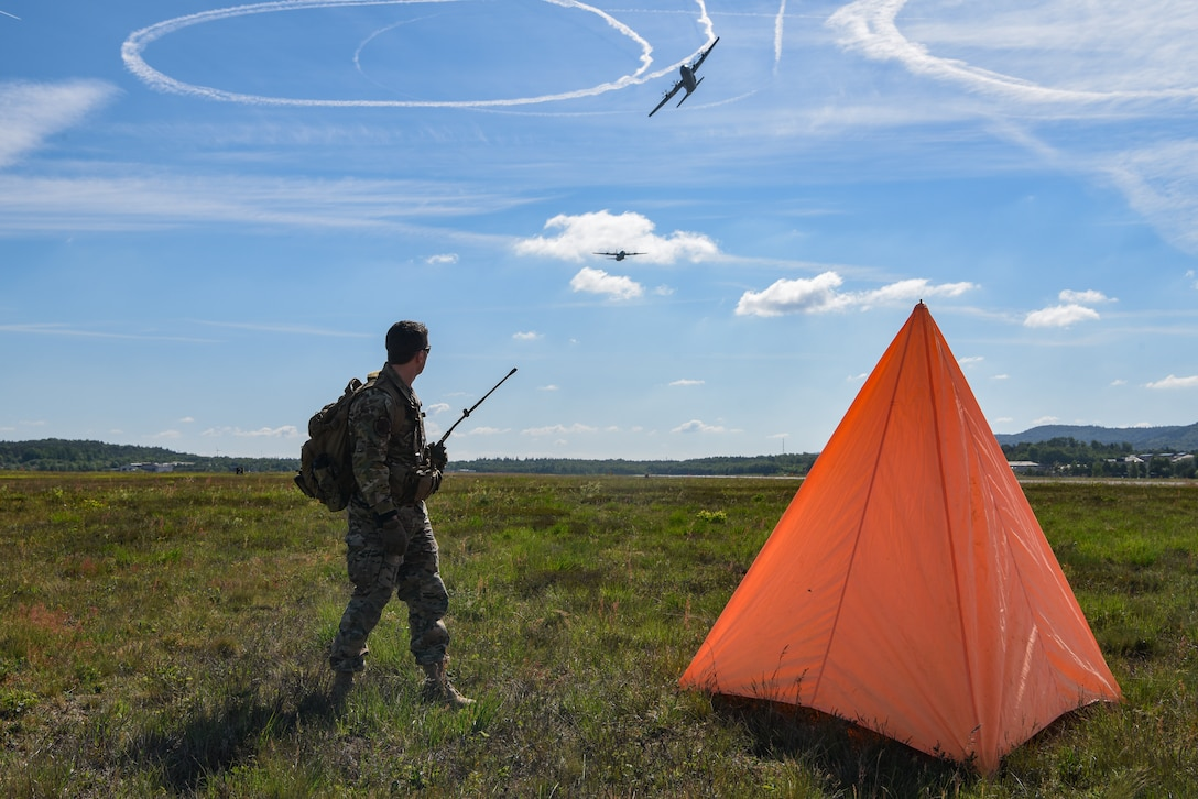 Photo of Airman setting up a drop zone for paratroopers