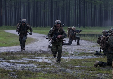 U.S. Marines with Force Reconnaissance (Recon) Company, 2d Recon Battalion, 2d Marine Division conduct a chance contact drill with a vehicle pick-up on Camp Lejeune, North Carolina, May 22, 2020. Force Recon Company conducted live-fire immediate action drills including vehicle drop-offs, vehicle pick-ups, and simulated casualty evacuations to enhance weapons familiarization and unit capabilities. (U.S. Marine Corps photo by Lance Cpl. Jacqueline Parsons)