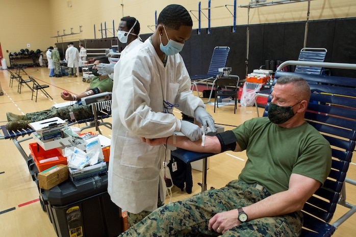 U.S. Marine Corps Lt. Gen. Robert F. Hedelund, the commanding general of U.S. Marine Corps Forces Command (MARFORCOM), Fleet Marine Force Atlantic (FMFLANT), donates blood during an Armed Services Blood Program (ASBP) blood drive at Hopkins Gymnasium on Camp Elmore, Norfolk, Virginia, May 28, 2020.