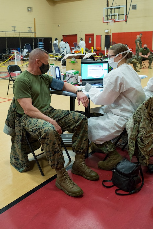 U.S. Marine Corps Lt. Gen. Robert F. Hedelund, the commanding general of U.S. Marine Corps Forces Command (MARFORCOM), Fleet Marine Force Atlantic (FMFLANT), gets his vitals checked during an Armed Services Blood Program (ASBP) blood drive at Hopkins Gymnasium on Camp Elmore, Norfolk, Virginia, May 28, 2020.