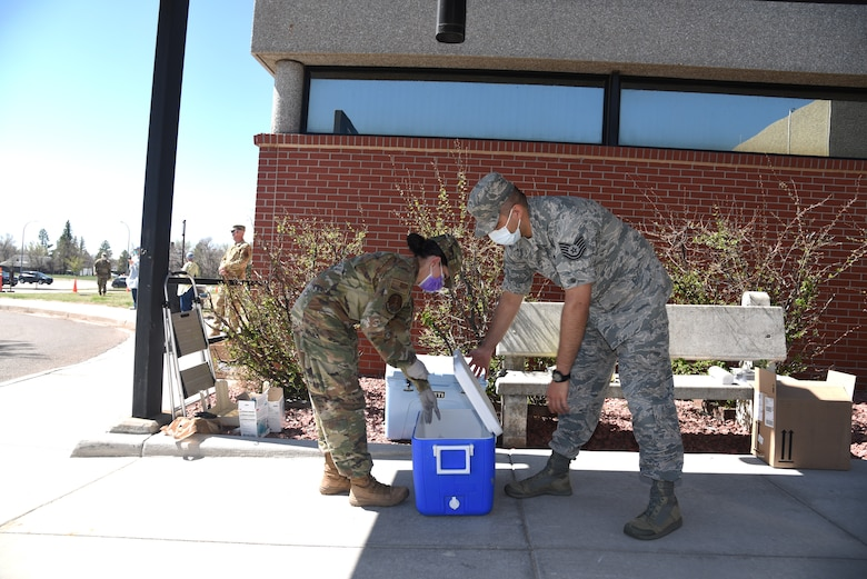 Airmen collect test kits