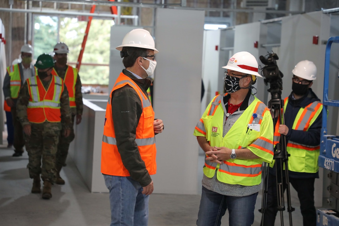 Ryan Field (right), Kalispell ACF project manager, USACE-Omaha, talks with Montana Governor Steve Bullock May 21, during a tour of the Kalispell, Mont., alternate care facility.