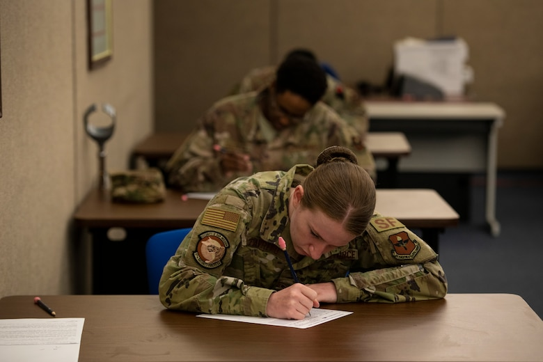 U.S. Air Force Senior Airman Jewel Favreau, assigned to the 97th Security Forces Squadron, fills out a promotion testing form, May 20, 2020 at Altus Air Force Base, Oklahoma
