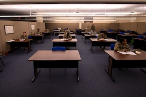 U.S. Air Force members fill out their Weighted Airman Promotion System testing sheets, May 20, 2020 at Altus Air Force Base, Oklahoma.