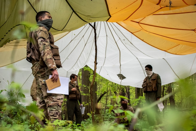 Aircrew from the 179th Airlift Wing Operations Group, Ohio National Guard, participate in combat survival training May 16, 2019, in Butler, Ohio. The 179th AW has made maintaining readiness while abiding by the COVID-19 safety precautions a priority throughout the COVID-19 Pandemic. (U.S. Air National Guard photo by Senior Airman Alexis Wade)