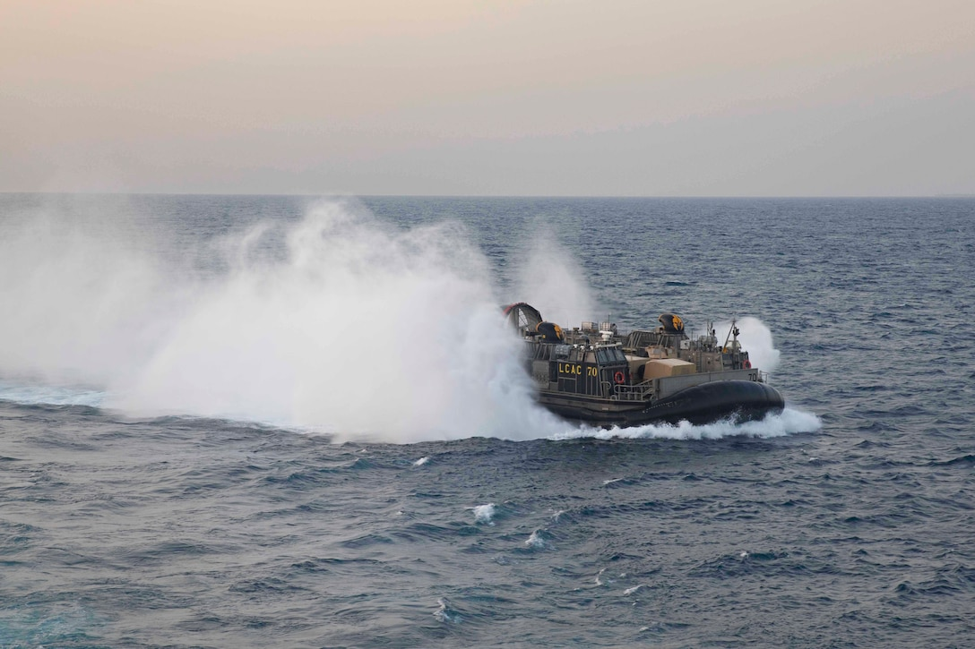 A Navy an air-cushioned landing craft travels through waters.