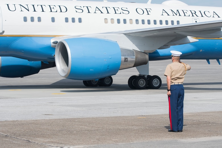 A Marine salutes Air Force Two as it taxis on the runway at Dobbins Air Reserve Base, Ga. May 29, 2020. Air Force Two landed here around 10 a.m., marking the second time in two weeks the vice president has visited Georgia. (U.S. Air Force photo/Andrew Park)