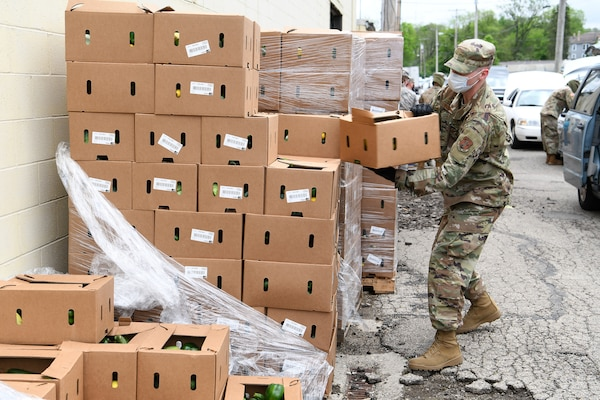 Staff Sgt. Lucas Williams, a radar technician assigned to the 123rd Air Control Squadron, Ohio National Guard, unwraps a pallet of boxes of food during the drive-thru food distribution May 22, 2020, at the Second Harvest Food Bank in Springfield, Ohio.