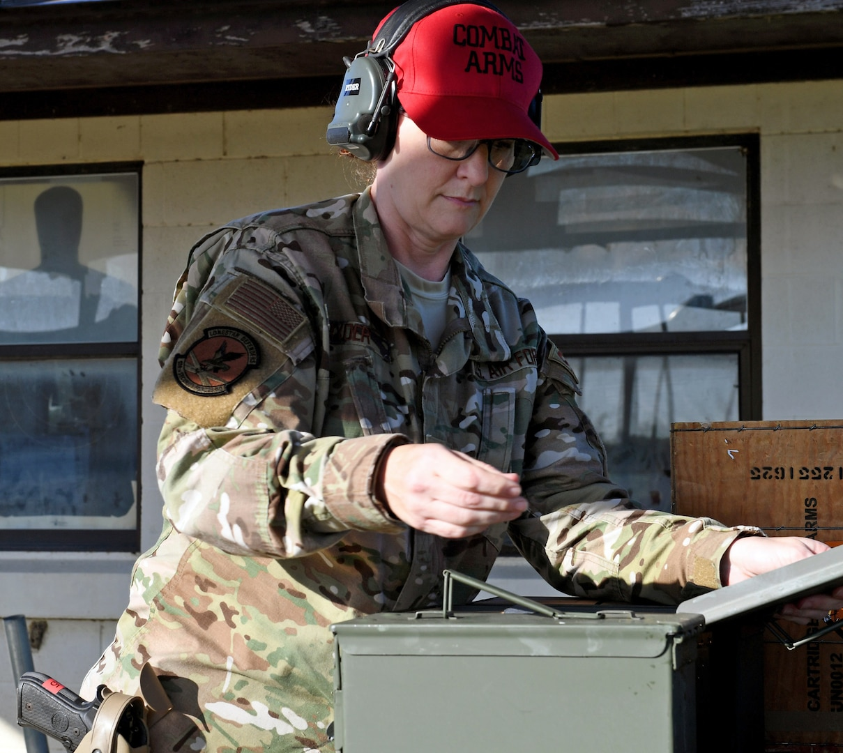 Staff Sgt. Tina Ryder, an Air National Guard Combat Arms instructor from the 149th Security Forces Squadron, prepares for weapons qualification training at a firing range at Joint Base San Antonio-Lackland's Chapman Training Annex May 27. Members from the 149th SFS received training on the M-9 pistol, the shotgun and grenades during this training event.