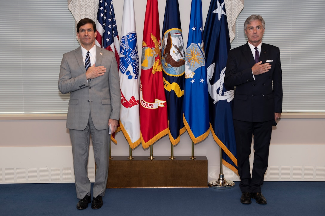 Defense Secretary Mark T. Esper prepares to swear-in retired Navy Rear Adm. Kenneth Braithwaite to serve as the next Secretary of the Navy in the Pentagon, May 29.