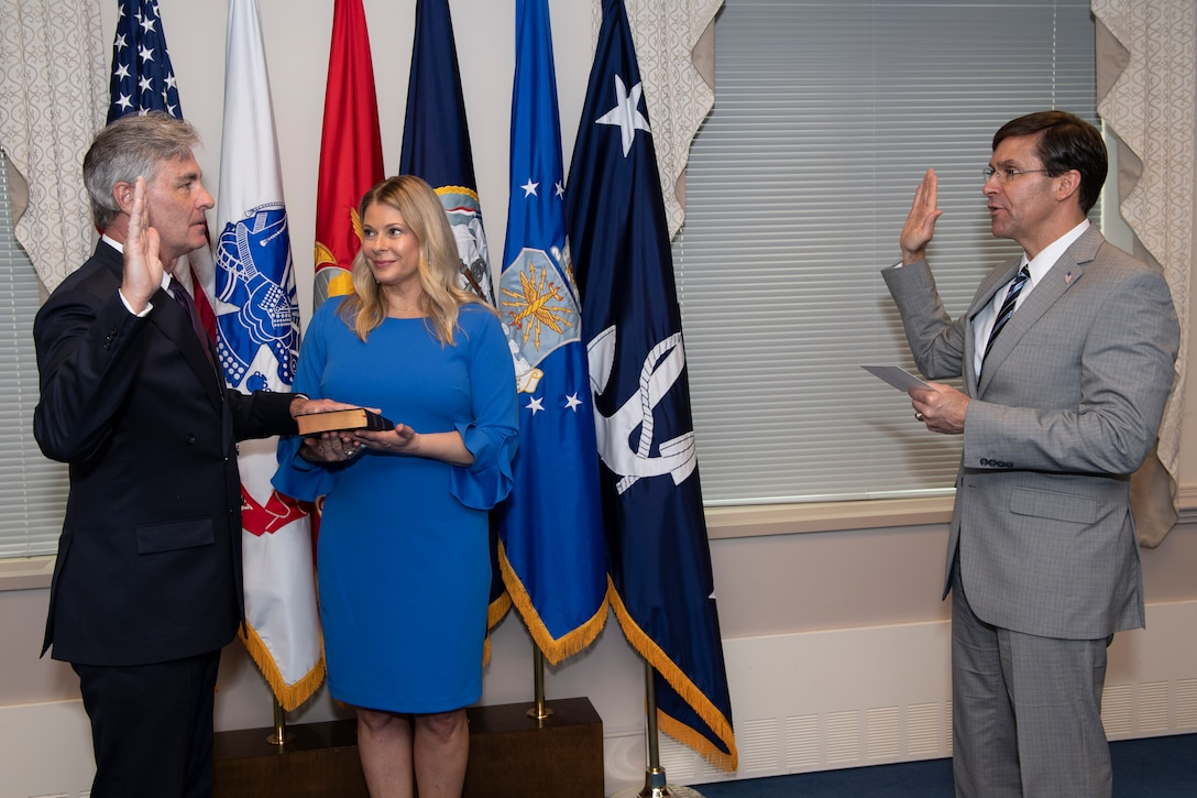 Defense Secretary Dr. Mark T. Esper swears-in retired Navy Rear Adm. Kenneth Braithwaite to serve as the next Secretary of the Navy, in Washington, D.C., May 29.