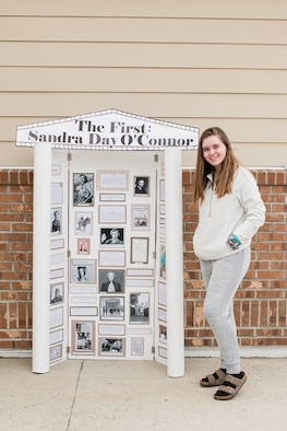 Emily Doucette, a Hanscom Middle School student, stands by her National history Day project at Hanscom Air Force Base, Mass. Doucette is one of seven HMS students to have advanced to the national-level, competing against students from across the U.S. and territories. (courtesy photo)