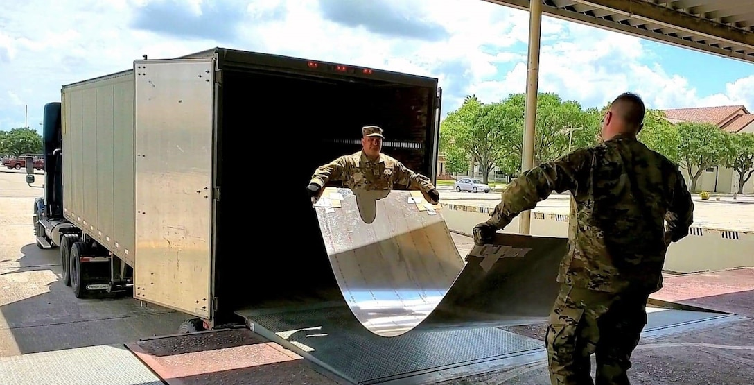 Master Sgt. Juan J. Guerra, a ground transportation section chief/quality assurance, with the 433rd Logistics Readiness Squadron at Joint Base San Antonio-Lackland, Texas helps offload sheet metal with an active duty Airman on May 27, 2020.